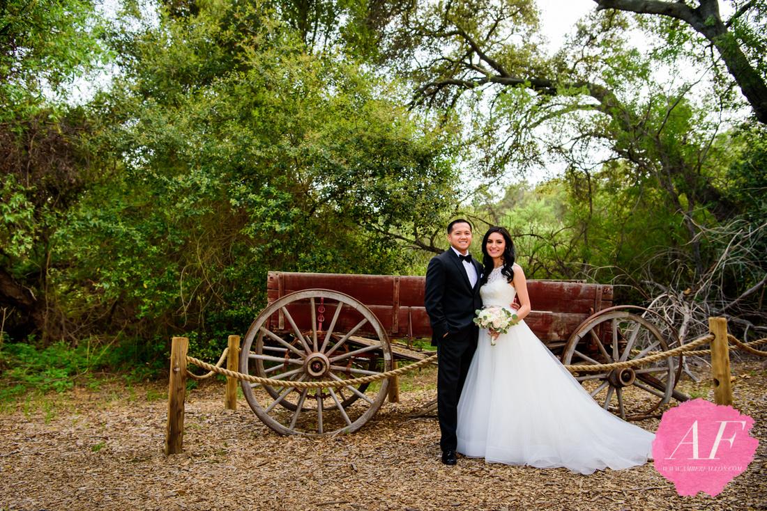 Romantic portrait of bride and groom in rustic woods during wedding day at Temecula Creek Inn in Temecula, San Diego, California