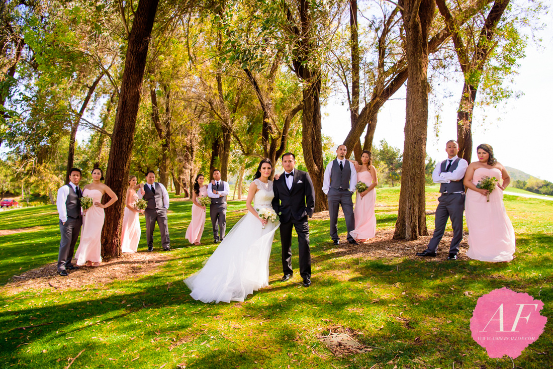 Modern portrait of bride and groom with wedding party in rustic woods during wedding day at Temecula Creek Inn in Temecula, San Diego, California