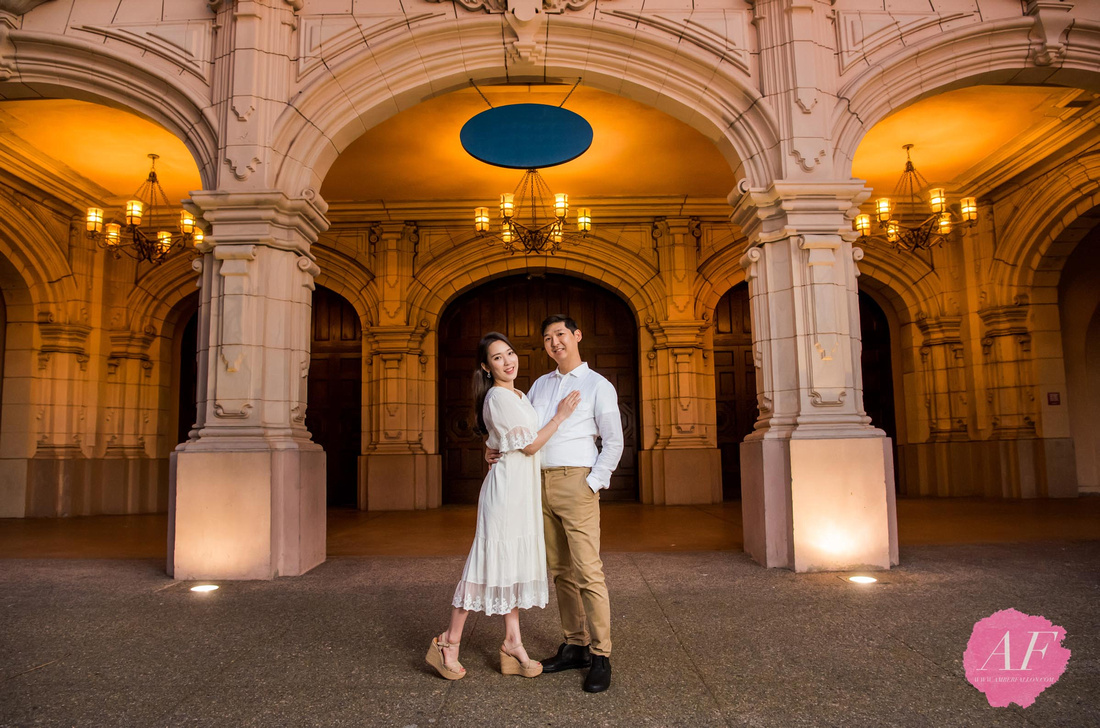 Night portrait of young, romantic couple during engagement session at the Botanical Garden and Timken Museum of Art at Balboa Park in San Diego, California