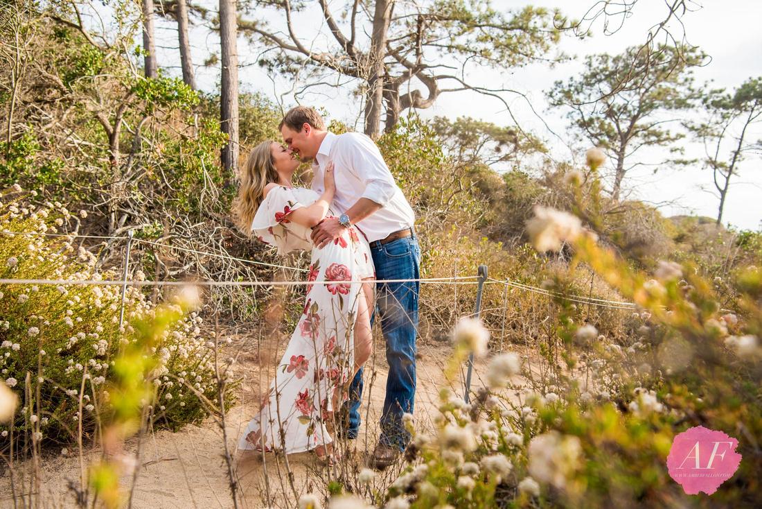 Romantic couple's proposal overlooking the coastline of La Jolla's Torrey Pines beach trail in San Diego, California