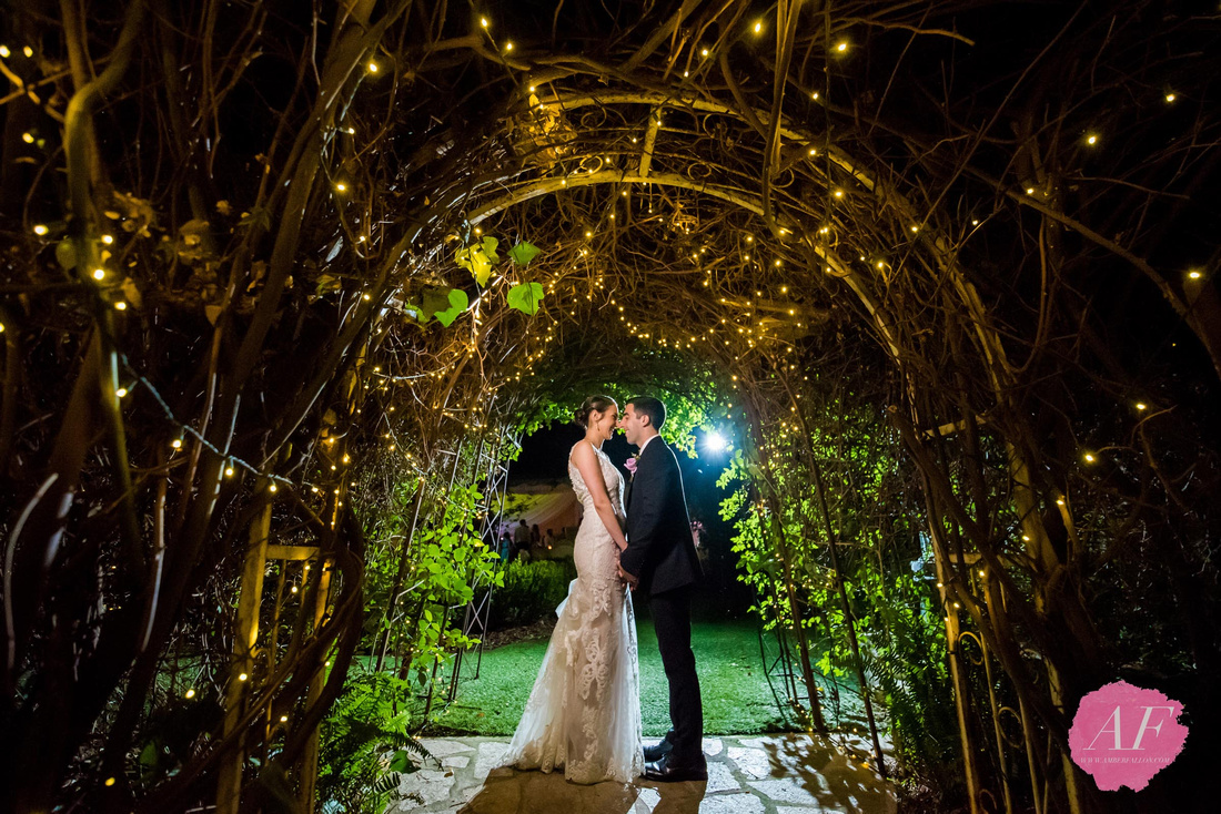 Creative night portrait of bride and groom during wedding reception at Twin Oaks Garden Estate in San Marcos, San Diego, California