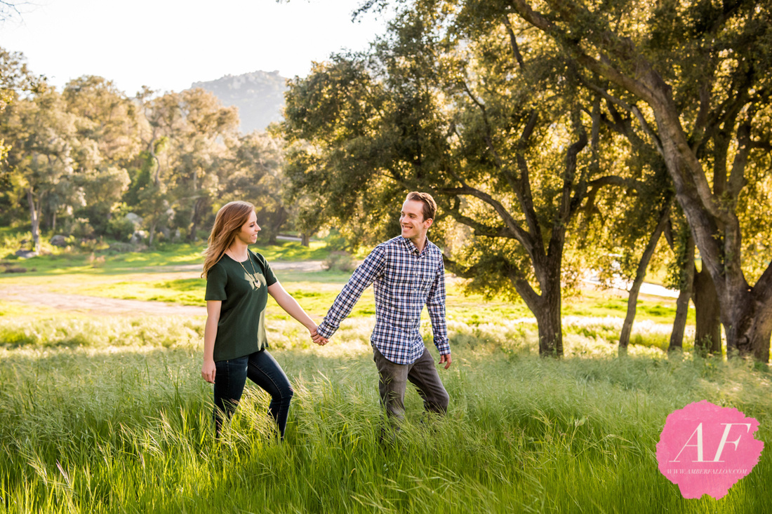 San Diego photographer, Amber Fallon, photographs cute, engaged couple in the rustic woods at Mt. Woodson Castle in Ramona, San Diego, California before their wedding day