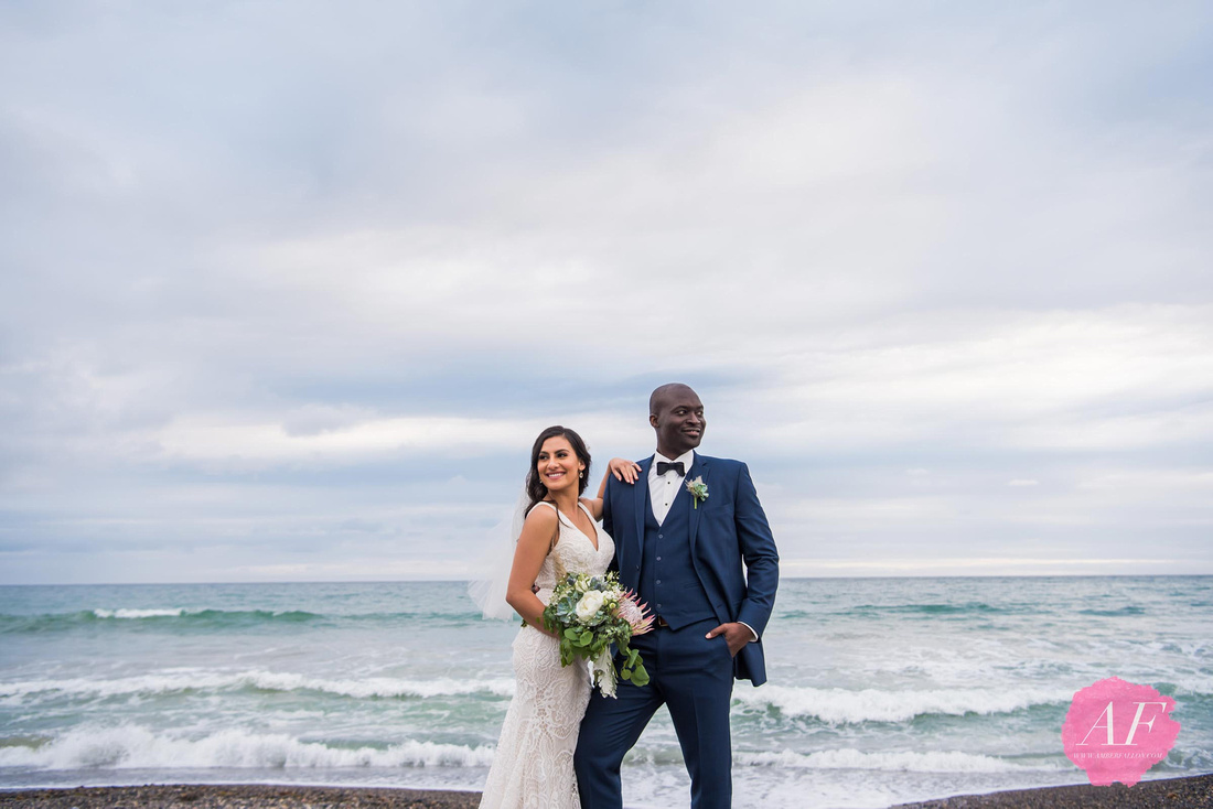 Portrait of multi-cultural bride and groom at beach during wedding day at Ole Hanson Beach Club in San Clemente, California