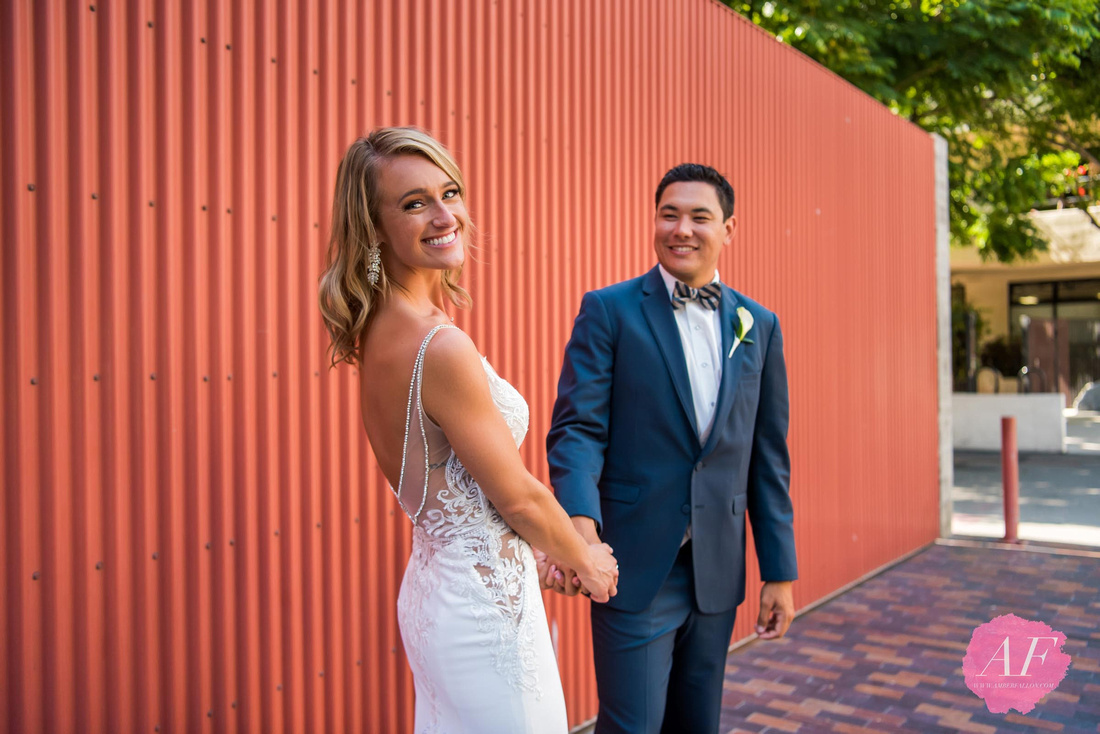 Artistic, colorful portrait of wedding couple photographed by Amber Fallon Photo at the Museum of Contemporary Art in Downtown San Diego, California.