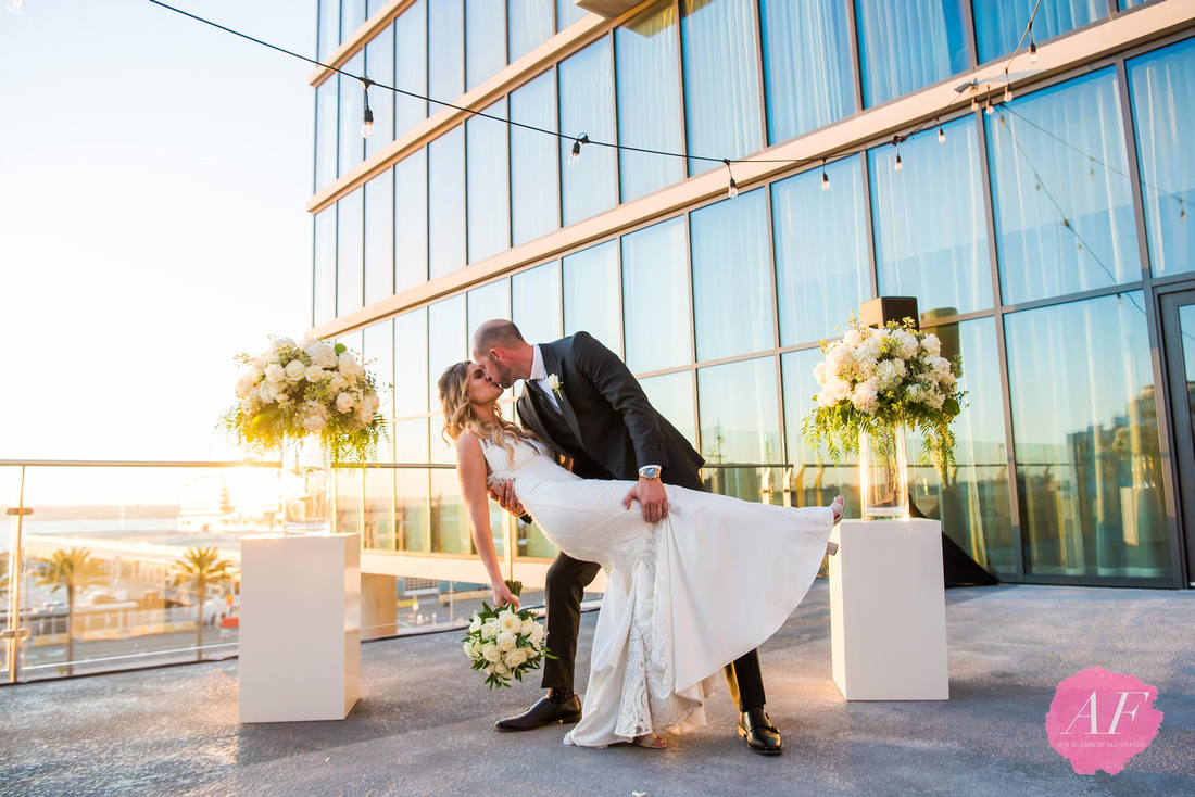 Modern couple get married at the Marriott Bayfront overlooking San Diego Harbor in downtown san diego, california.