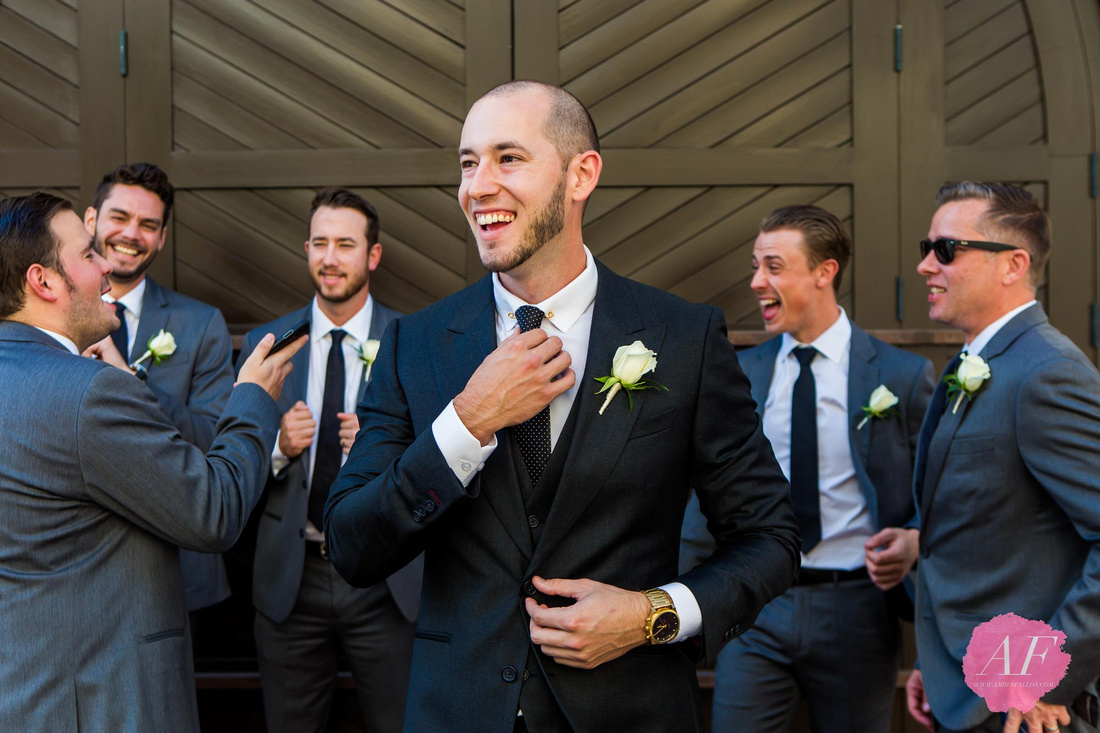 Groomsmen in suits in Downtown San Diego, California on wedding day at Ultimate Skybox