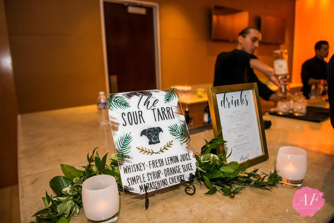 Bride and Groom personalized cocktails and creative handmade signage at modern wedding reception in the Ultimate Skybox in Downtown San Diego, California