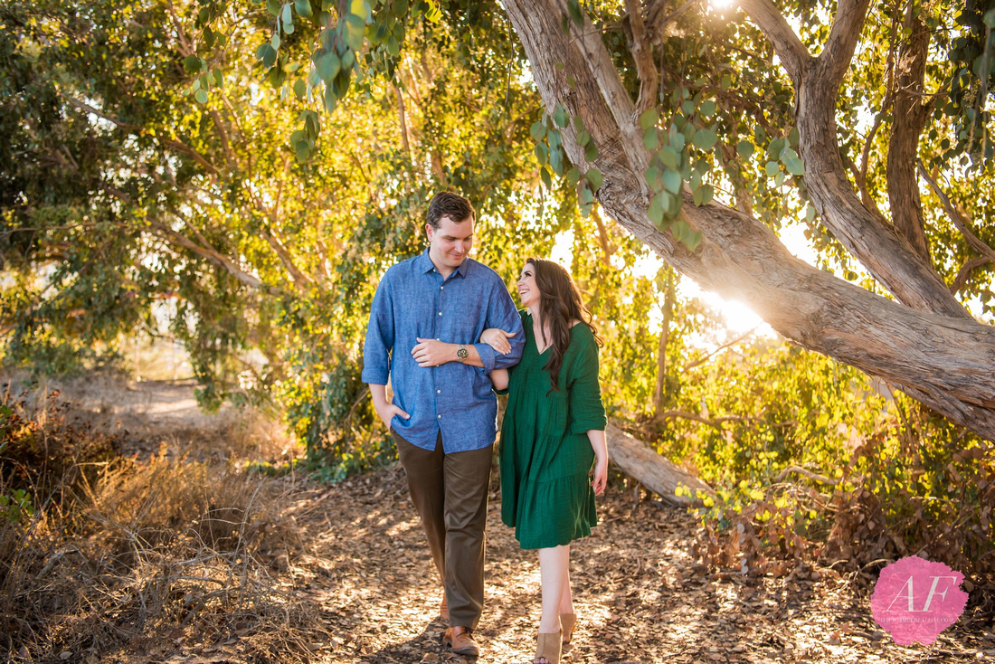 Playful and rustic couple's engagement session at Hidden Swing overlooking the La Jolla Coast in San Diego, California