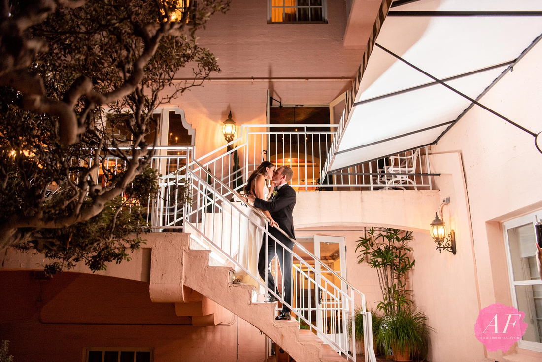 Night portrait of bride and groom during modern, classic wedding at the historic, spanish-style La Valencia Hotel with breathtaking views of the ocean in La Jolla, San Diego, California