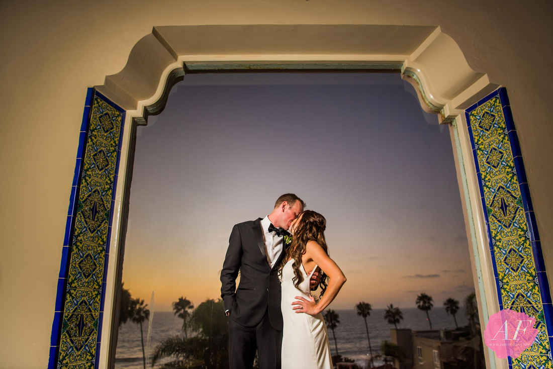Sunset portrait of modern, classic wedding couple at the historic, spanish-style La Valencia Hotel with breathtaking views of the ocean in La Jolla, San Diego, California