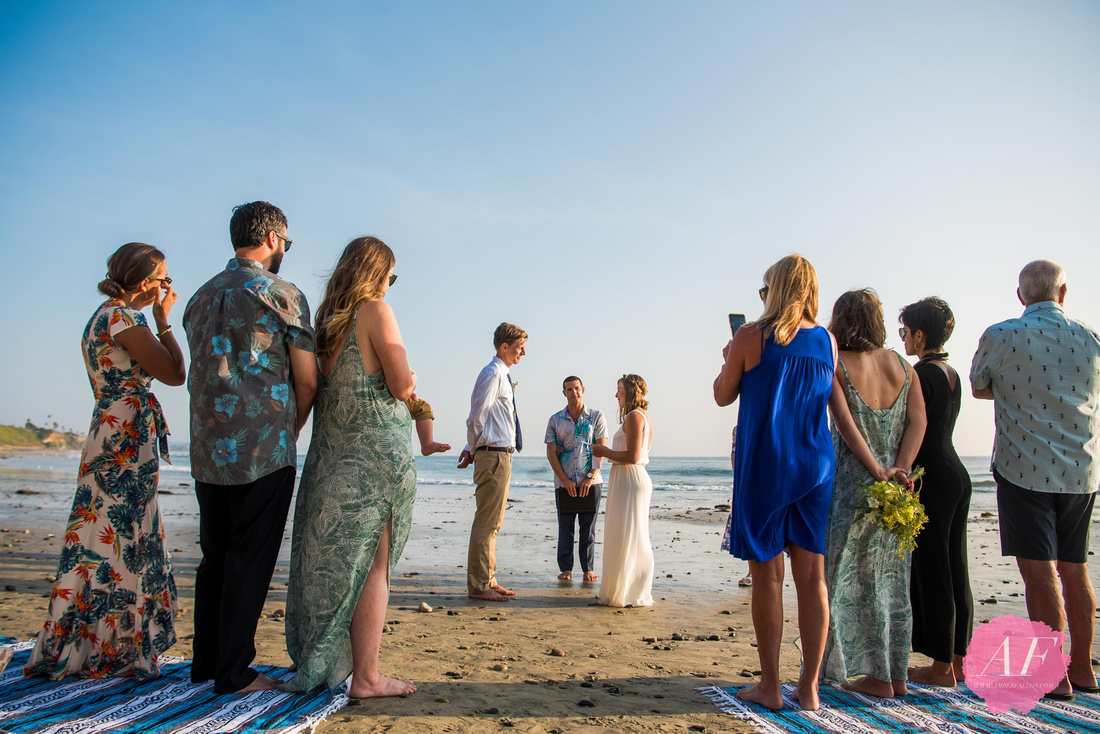 Surfer, vanlife wedding couple exchange vows during sunset at intimate beach elopement in Encinitas, California